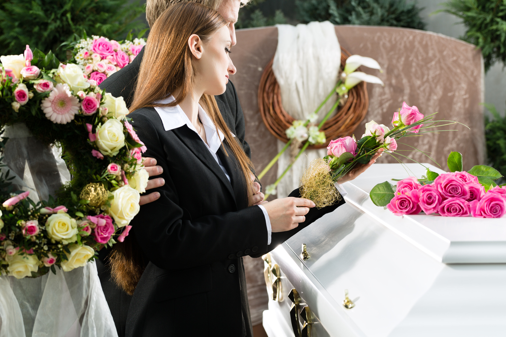The History And Traditions Behind Funeral Flowers